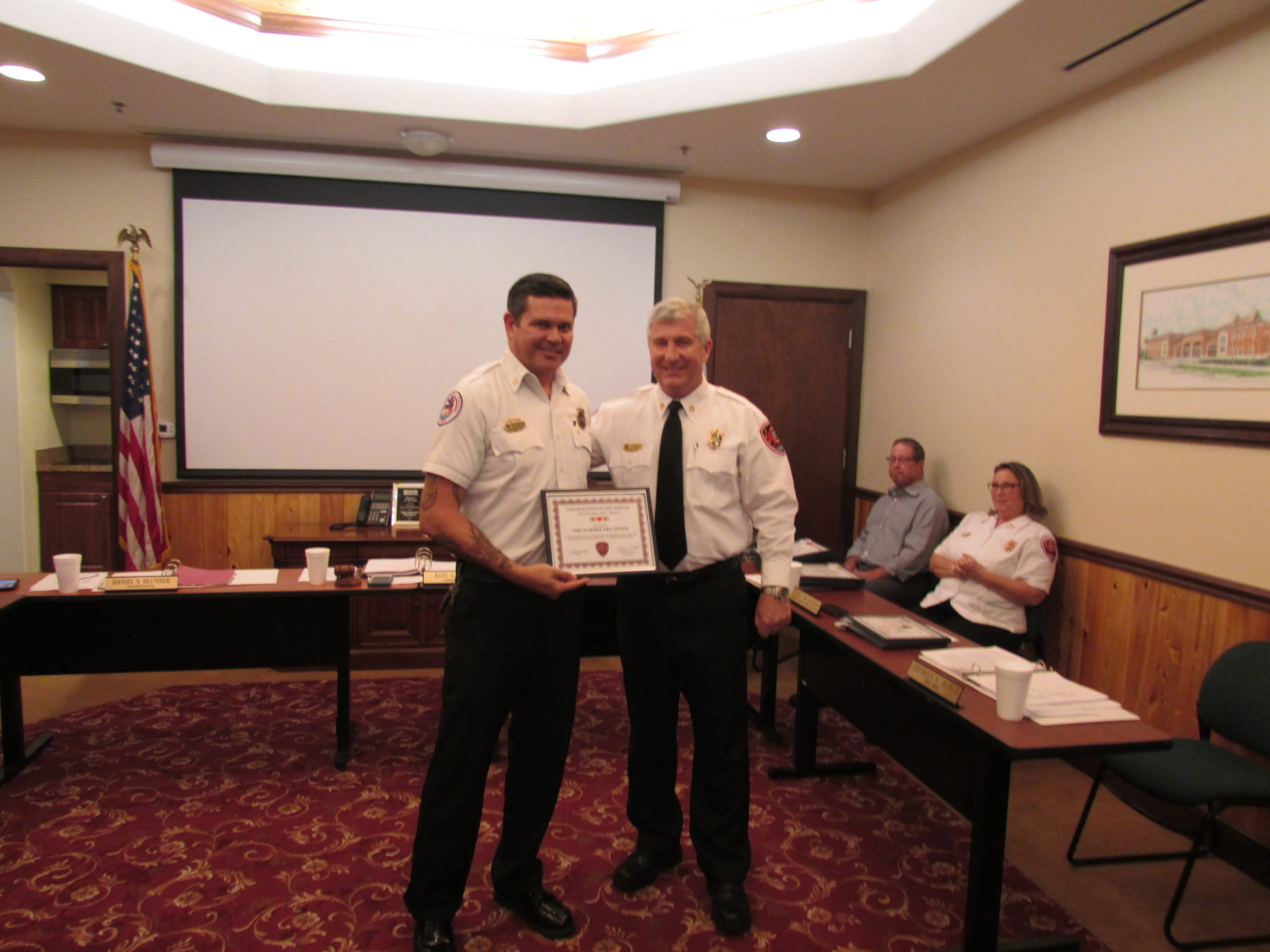 fire marshal center receiving exceptional duty award from chief hoyle