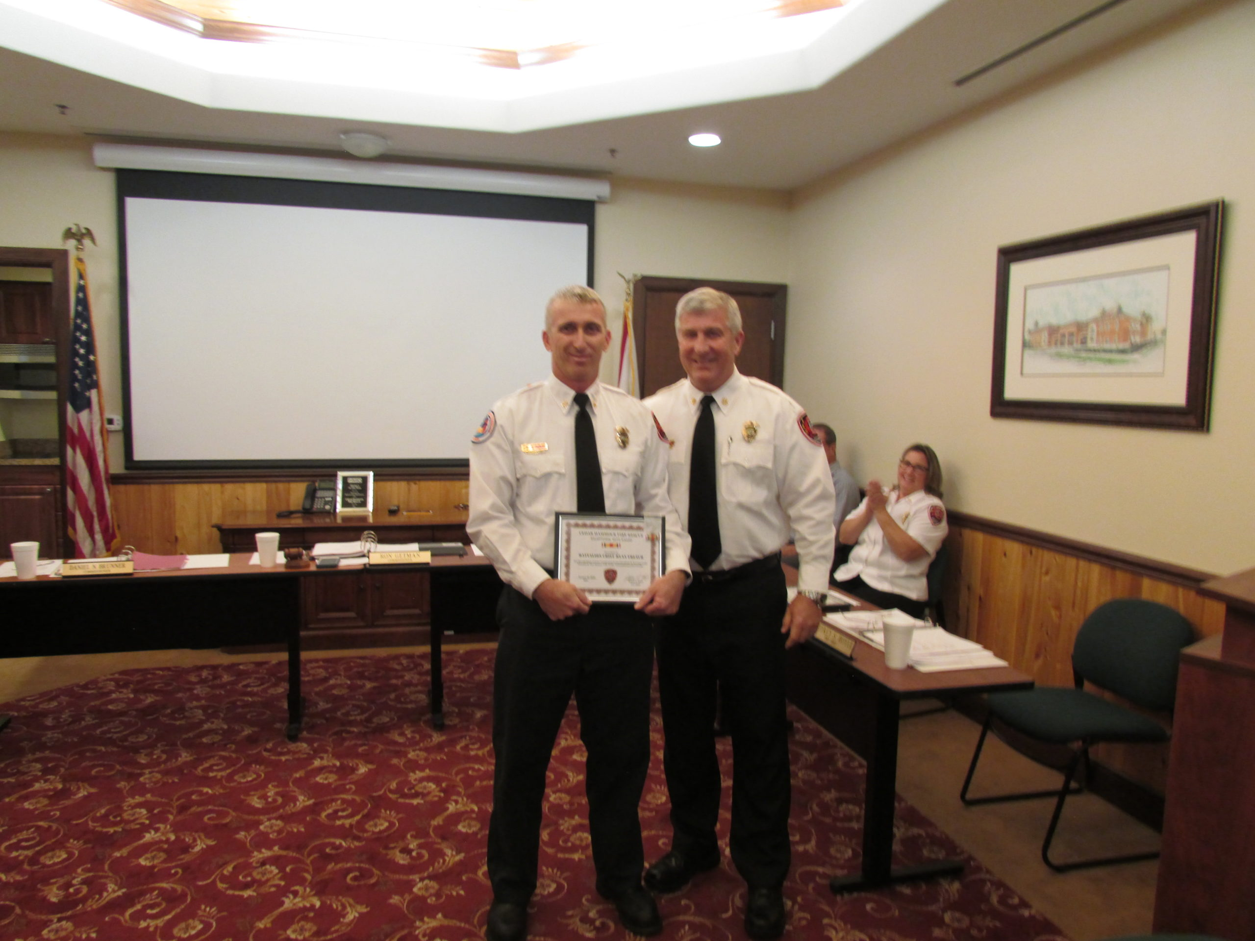 battalion chief french receiving exceptional duty award from chief hoyle
