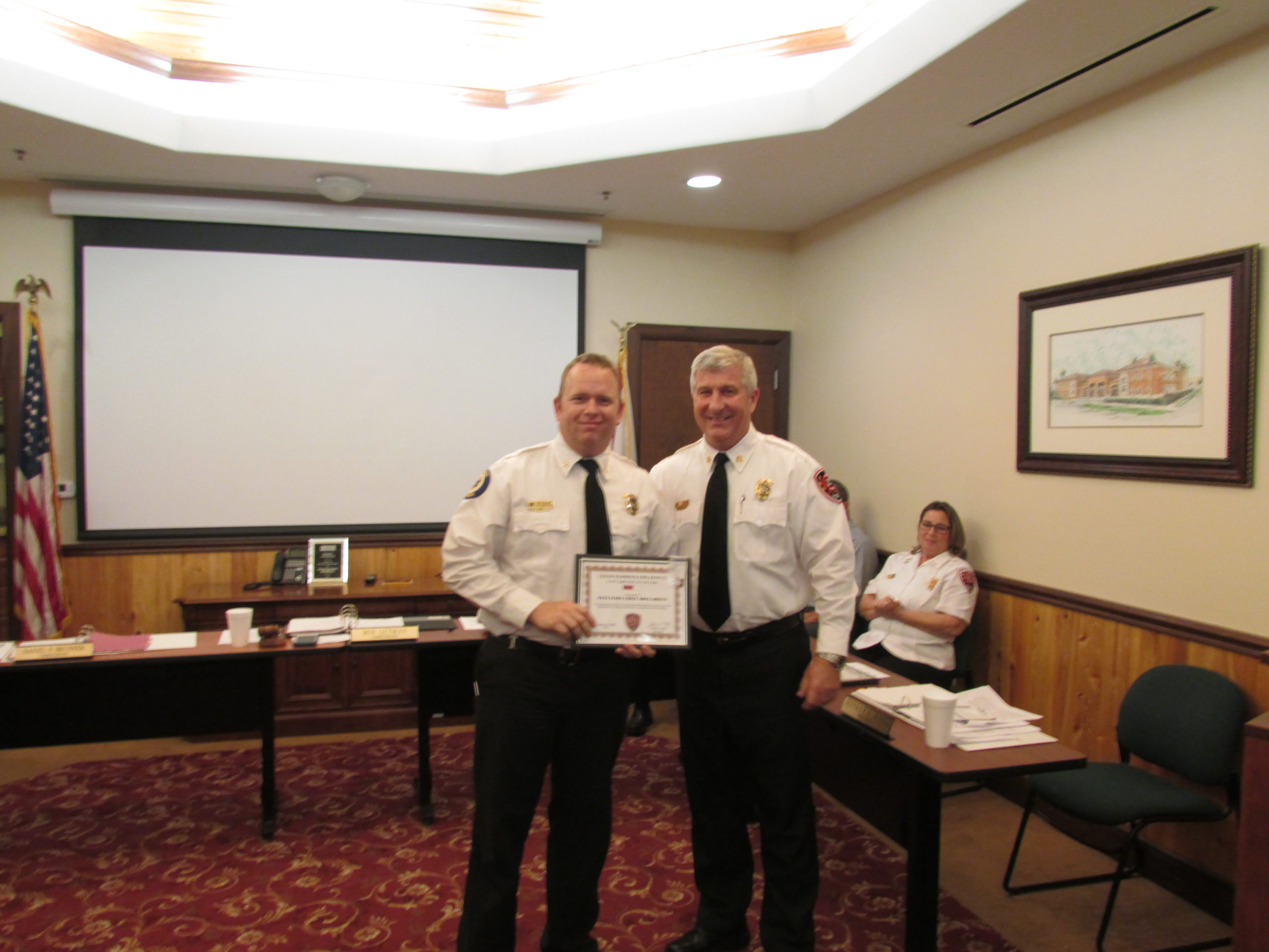 battalion chief doug brett receiving the staff employee of the year award from chief hoyle